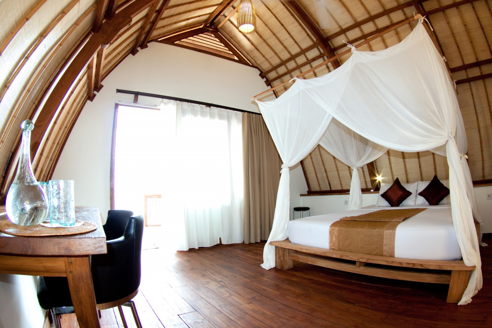 Beach cabanas are styled after lumbung rice barns. Photo by Komodo Resort & Diving Club