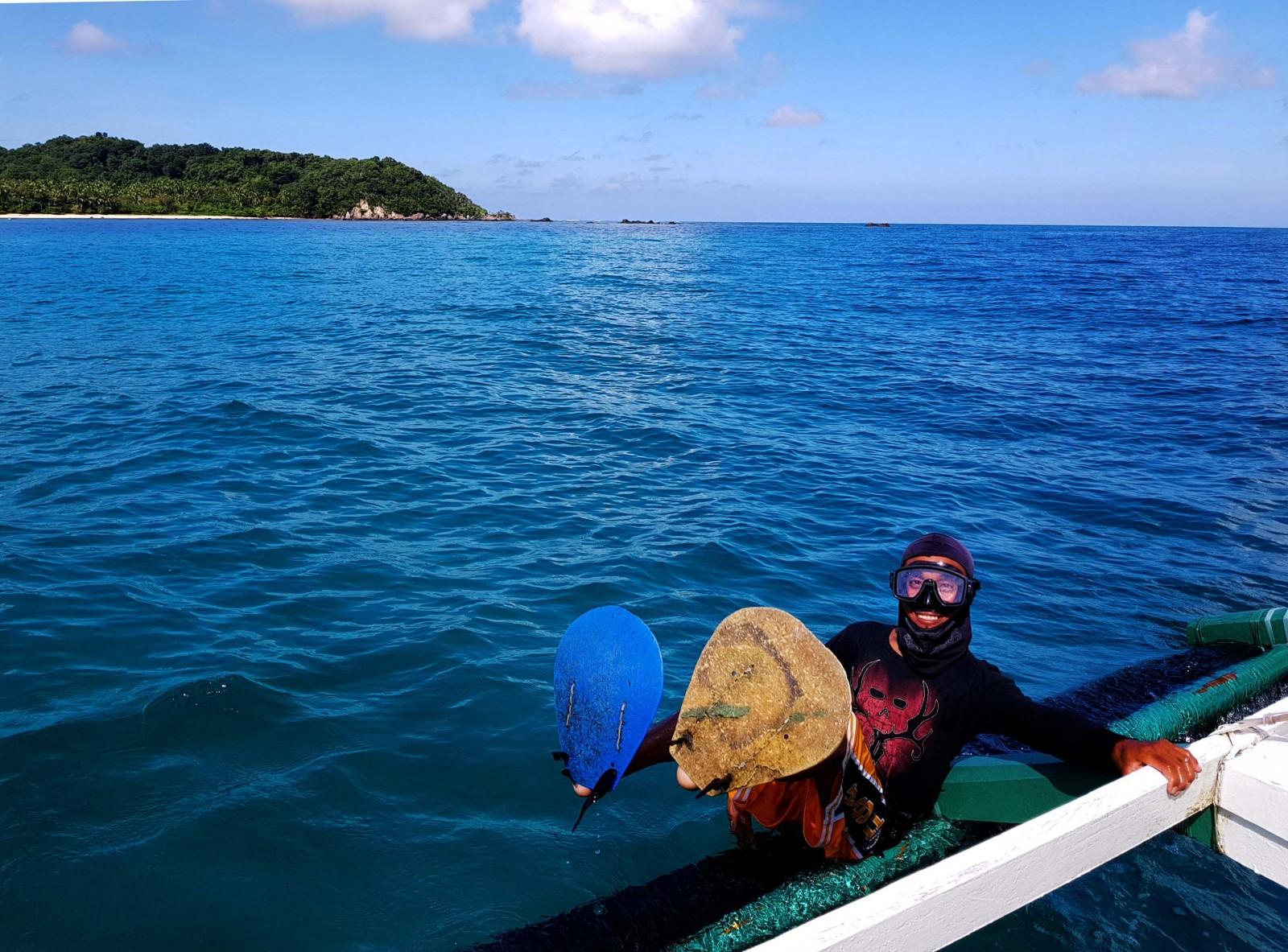 dugong-dive-by-gregg-yan-1.jpg