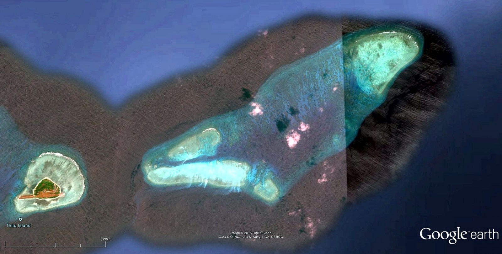 Google Earth image of Thitu Reef, the 'checkmark' reef and Tieshi Reef